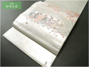 長嶋成織物の由水十久図案袋帯